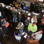 An aerial view of patrons socializing at the Winery.